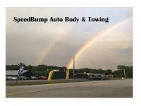 Speed bump auto body _ Towing.jpg